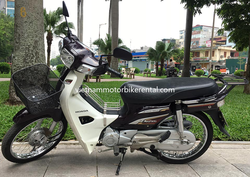 Vietnam Motorbike Hanoi Rental - Scooters For Beginners. Vietnam Motorbike Hanoi Rental provides moped scooter tours and rentals in Hanoi. This is a 2014 brown Honda Super Dream 110cc with front and back drum brakes.