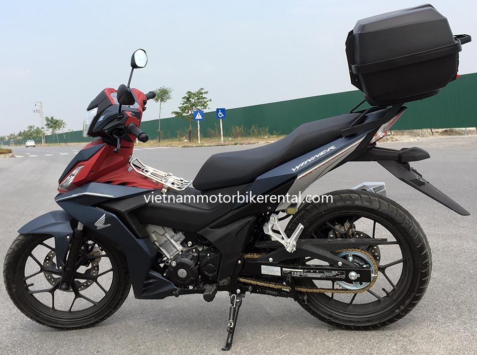 Vietnam Motorbike Hanoi Rental - Motorcycles, Scooters For Beginners. Vietnam Motorbike Hanoi Rental provides moped scooter tours and rentals in Hanoi. This is a brown and red 2016 Honda Winner 150cc with front and back disc brakes.