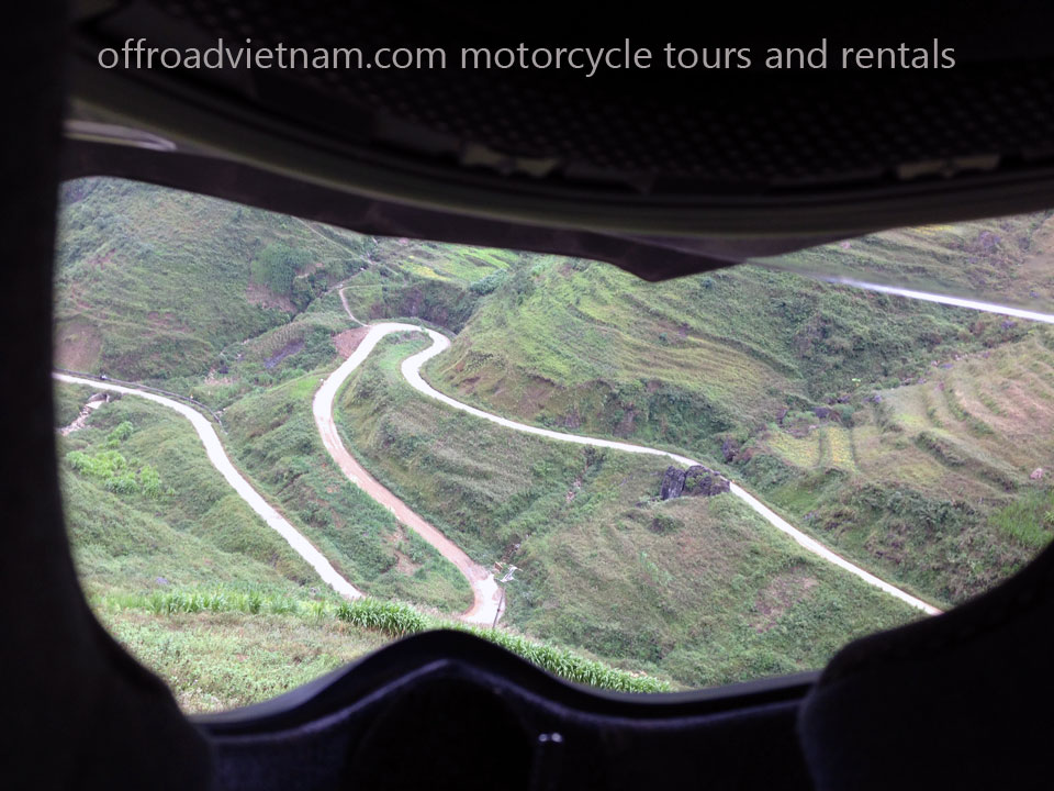 Vietnam Motorbike Hanoi Rental - Links & Resources. Vietnam Ha Giang mountain road from a rider's helmet view.