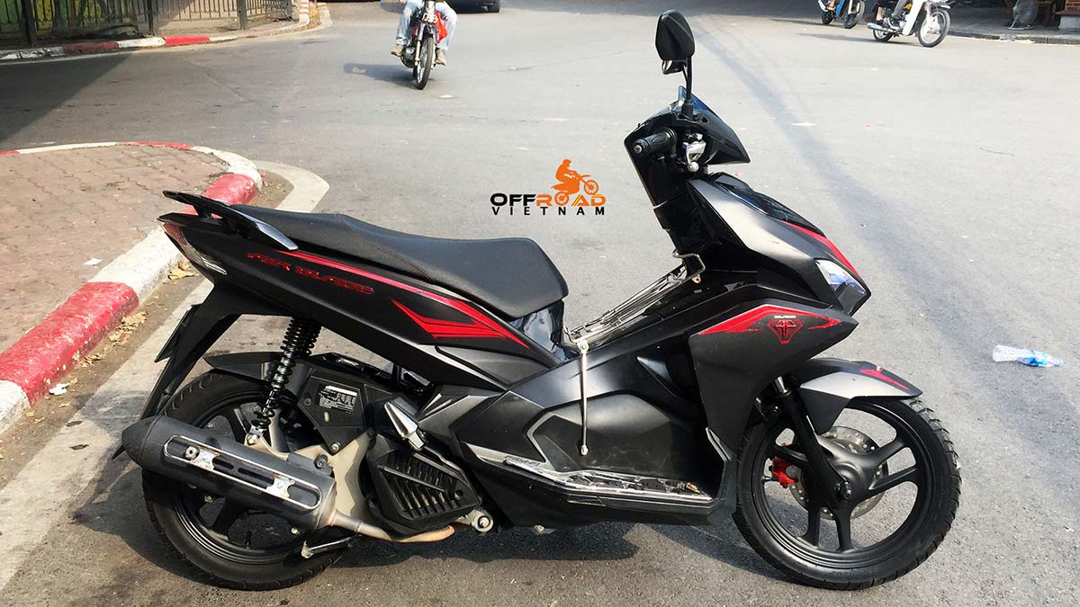 Vietnam Motorbike Hanoi Rental - Scooters For Beginners. Vietnam Motorbike Hanoi Rental provides moped scooter tours and rentals in Hanoi. This is a 2013 red/black Honda Air Blade 125cc with front disk brake.