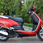 Red Honda Lead 110cc. Discontinued in 2013.